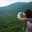 Woman taking photographs the landscape of mountain — Stock Photo #66583301