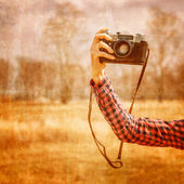 Hand with vintage photo camera — Stock Photo