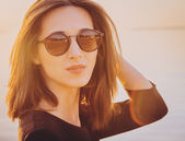 Woman in round sunglasses — Stock Photo