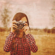 Girl with photo camera — Stock Photo #69361069