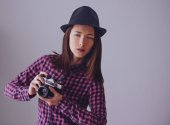 Hipster girl with old photo camera — Stock Photo