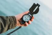 Hiker searching direction with compass — Stock Photo
