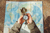 Traveler searching direction with compass — Stock Photo