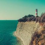 Lighthouse on coast near sea — Stock Photo #76081493