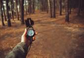 Woman searching direction with compass — Stock Photo