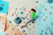 Woman exercising in climbing gym — Stock Photo