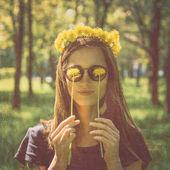 Woman in wreath of yellow dandelions — Stock Photo