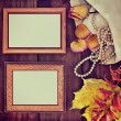 Photo frames with old jewelry — Stock Photo #55959353