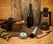 Vintage kerosene lamp, spyglass and a bottle — Stock Photo