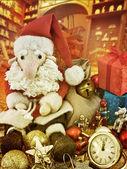 Santa Claus sitting among antique toys — Foto de Stock