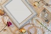Romantic frame with female jewelry — Stock Photo