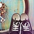 Shoes and a bicycle wheel — Stock Photo #64733645