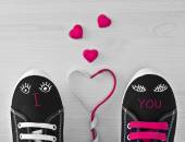 Valentine's Sneakers with laces and eyes. — Stock Photo