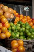 Limes and Oranges — Stock Photo