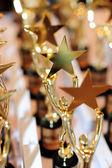 Human holding star gold award Trophy  — Stock Photo