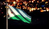 Djibouti National Flag City Light Night Bokeh Background 3D — Foto de Stock