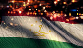 Tajikistan National Flag Light Night Bokeh Abstract Background — Stock Photo