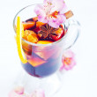 Flowers and mulled wine in glass — Stock Photo #60761423