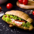Постер, плакат: Croissant sandwich with salted salmon