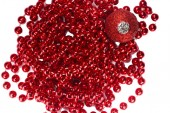 Red Christmas beads and ornament — Stock Photo