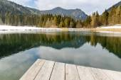 Landscape view of lake and mountains from the wooden pier — Stock Photo
