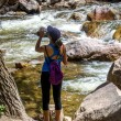 Постер, плакат: Active woman hiker hydrating