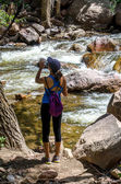 Active woman hiker hydrating — Stock Photo