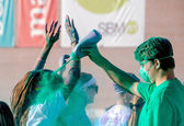 Green workers in a color run race — Stock Photo