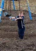 Batole chlapce a swing — Stock fotografie