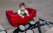 Sad boy and wagon, some assembly required — Stock Photo