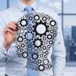 Businessman drawing gears — Stock Photo #59760865
