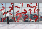 Falling red question mark — Stock Photo