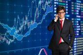 Businessman talking on cellphone — Stock Photo