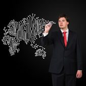 Businessman  drawing microcircuit — Stock Photo