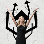Woman with arrow tree over head — Stock Photo