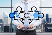 Businessman holding puzzle — Stock Photo