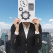 Woman holding poster with gear — Stock Photo #61593505