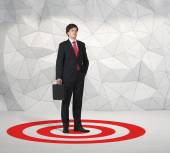 Businessman standing on target — Stock Photo