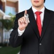 Businessman is holding a key — Stock Photo #61861533