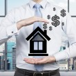 Businessman holding drawing house — Stock Photo #62604553