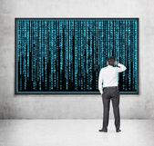 Businessman looking to matrix — Stock Photo
