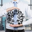 Businessman holding business icon — Stock Photo #63502837