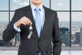 Businessman holding key — Stock Photo