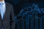 Businessman and stock chart — Stock Photo