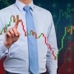 Businessman touching chart — Stock Photo #63775013