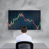 Businessman looking on chart — Stock Photo