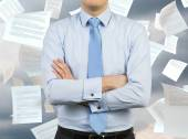 Man and falling papers — Stock Photo