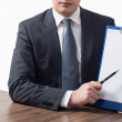 Businessman holding blank clipboard — Stock Photo #64386061