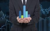 Businessman holding chart — Stock Photo