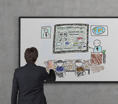 Businessman drawing education — Stock Photo